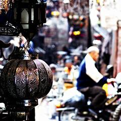 marrakech : magic lantern (gregjack!) Tags: light people blur colour focus dof market bokeh morocco marrakech souk medina lantern
