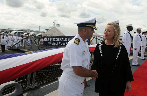 Secretary of State Hillary Clinton is greeted by Cmdr. Brian Mutty, commanding officer of USS Fitzgerald.