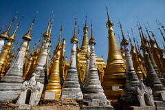 Stupas at Shwe Inn Dein (Lil [Kristen Elsby]) Tags: travel topf25 topv2222 architecture temple gold pagoda asia burma stupa bama buddhism wideangle getty myanmar inlelake gilded gettyimages gilt canon1635f28l travelphotography myanma canon163528l shweinnthein canon5dmarkii innthein shweinndain myanmar2012 inndain