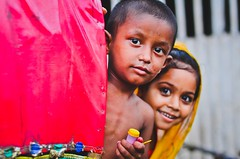 Colors of childhood (A. adnan) Tags: street portrait girl beautiful smile eyes nikon colours dof bangladesh nikkor50mmf14d nikon50mmf14d bangladeshiphotographer peopleofbangladesh aadnan613