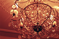 Small chandelier with attractive pink/orange hue... (Joybot) Tags: orange classic film glass yellow sepia 35mm vintage 50mm warm glow candle crystal small rich drop ceiling pale chandelier bead elegant hue hang fujica opulent candelabra facet opulence stx1n