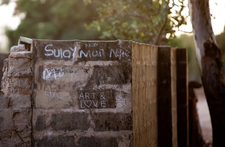 Chalk on wall. by Locals and Remed. GAMBIA