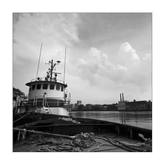 B&W_boat (Geoff Sills) Tags: street old sky bw white black beach home water clouds ga river georgia square boat nice interesting dock nikon pretty geoff william rope front savannah 28 tug geoffrey channel sills 1424 d700
