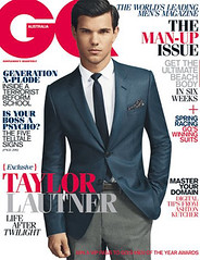 Taylor Lautner on the cover of GQ Australia. He's wearing a blue suit and looking at the camera