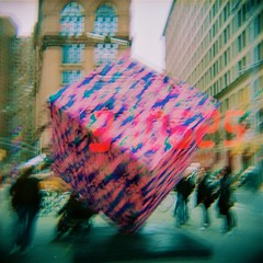 Yarn (emibell) Tags: newyorkcity pink red newyork blur color green outdoors holga lomo lomography purple alt doubleexposure manhattan days yarn numbers installation cube publicart astorplace brief countdown thecube colorflash bystanders outdoorart cfp colorfilm 2011 installationpiece astorplacecube holgacolorflash zuccottipark publicstatement colorfilmphotography yarnbombing yarnbombed emibell occupywallstreet occupywallstreetbase astorcubegetsyarnbombed wallstreetnumbers astoryarn yarncube 310625