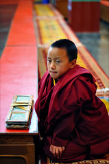 Little Monk III (Saptak Ganguly) Tags: life boy portrait india nikon sweet buddhist indian religion culture monk monastery thinking sikkim 2010 youngmonks saptak lifeinindia