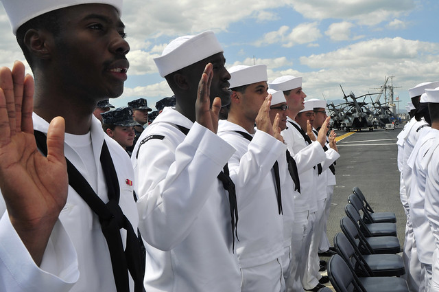 Sailors take the oath of allegiance during a naturalization ceremony held aboard USS Essex