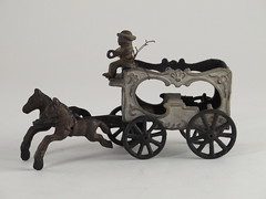 269. Cast Iron Coach Toy