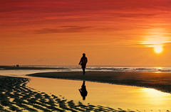 Walking Under a Blood Red Sky (RobK1964) Tags: sunset reflection beach walking sand surf horizon thenetherlands tranquility calm serenity getty serene lowtide breakers stroll thehague underabloodredsky cokinp121s coalplamt