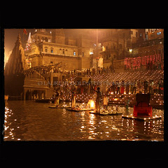 Sanctifying Ourselves (designldg) Tags: light people india reflection heritage water festival mystery night river spectacular temple candle view faith dream culture atmosphere celebration soul devotion varanasi priest shiva devotee hindu eternity dharma hinduism kashi timeless ganga ganges benares benaras ghat diya deeya uttarpradesh  indiasong devdiwali