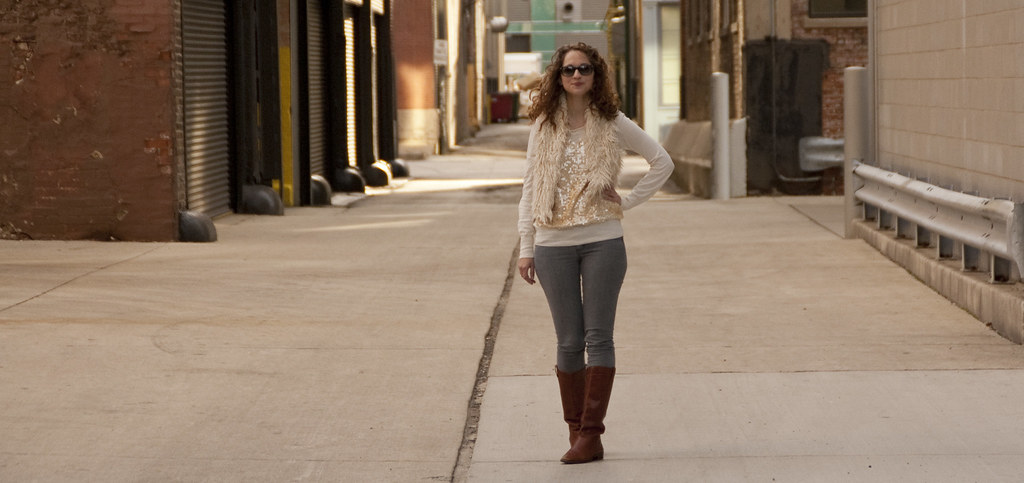 november outfit, dash dot dotty, outfit blog, cognac boots, sequins, mongolian fur vest, gray jeans, j.crew