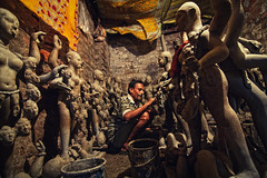 Artist busy working on clay idols of Goddess Kali (Sukanta Maikap Photography) Tags: india streetphotography diwali kolkata calcutta westbengal kalipuja dipabali tokina1116f28 goddesskaliidols clayidolshalffinishedidols unfinishedkaliidols canon450dtokinaatxprosd1116mmf28ifdx somewherenearkumartuli