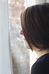 At the window 5 (Lucio.V) Tags: portrait woman cute window girl canon hair 50mm donna day finestra ritratto capelli giorno