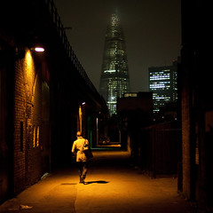 Find your way (Gary Kinsman) Tags: southwark se1 arches london lowlight availablelight canoneos5dmarkii canon5dmkii theshard shardlondonbridge shard canon50mmf14 alley backstreet construction skyscraper tower highrise architecture green highiso iso2000 mist f14 back ewerstreet 2011 people person