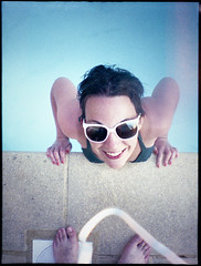 Fun is shining [IRM] (Bourguiboeuf) Tags: summer portrait sun france color film water pool girl sunglasses 35mm soleil lomo eau fuji superia mini iso 1600 swimmingpool diana portraiture analogue t lunettes pieds fille couleur piscine argentique privas lomograpyhy