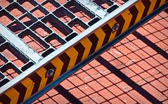 Industrial Grade (jaxxon) Tags: shadow urban abstract macro geometric metal lens prime nikon ramp pattern shadows angle geometry bricks angles micro arrows fixed abstraction 28 mm nikkor tread f28 vr afs 105mm 105mmf28 d90 nikor f28g gvr jaxxon 105mmf28gvrmicro nikkor105mmf28gvrmicro nikon105mmf28gvrmicro jacksoncarson