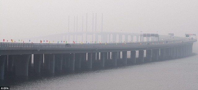That is a £1bn bridge too far World's longest sea bridge opens to traffic in China... but it will only hold the title for five years  9