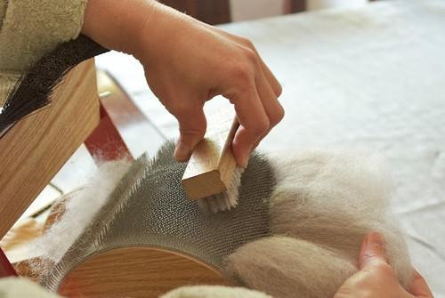 brushing stray fiber into the batt