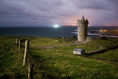 under the light of a pale moon (manyfires) Tags: longexposure ireland castle fence landscape evening moonlight aranislands countyclare doonagorecastle