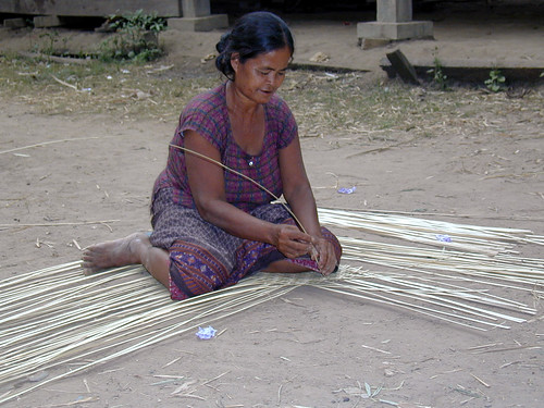 Woman weaving a fishing trap, Ban Hang Saddam, Don Khong, Laos. Photo by Eric Baran, 2000