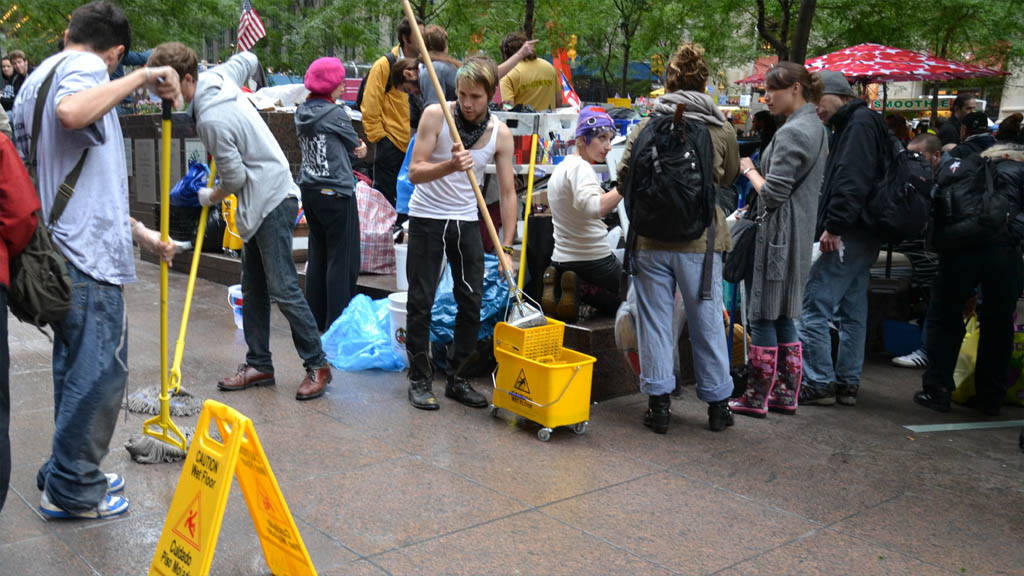 Occupy Wall Street Protesters Clean Zuccotti Park - © 2011 NLNY/Harrie Van Veen CC BY 2.0 DOOM! Magazine