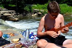 nate and his uke (c_elizabeth) Tags: boy summer river ukulele nikond3100