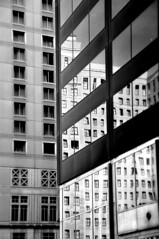 from one into the other (damonabnormal) Tags: street city windows urban blackandwhite bw reflection philadelphia glass mirror nikon october streetphotography mirrors pa tuesday philly phl 215 urbanite 2011 d90 18200vr urbanreflections