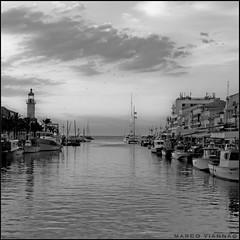 El Gran Canal (m@tr) Tags: sunset bw france blancoynegro canon monocromo tamron legrauduroi canoneos400ddigital elgrancanal mtr marcovianna tamron18200mmf3563diiixr portlacamargue imagenesdefrancia fotosdefrancia
