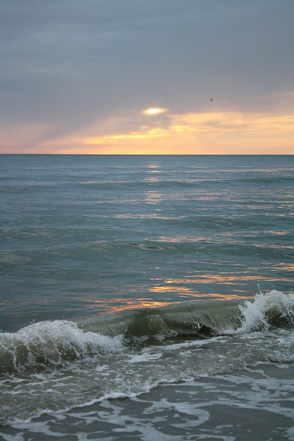 "Most of our beach days were overcast.... this is the ""prettiest"" sky/sunset I saw while in Florida. Not too impressive ;-("