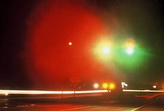Hazy Night (David Schuyler Matthews) Tags: red color green misty fog night streetlight streetlights foggy rainy lighttrail