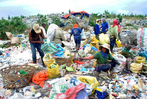 The members of the Barangay Inayawan Scavengers Association (BISA) work hand in hand to segregate recyclables from biodegradable and other non-biodegradable wastes at the Cebu City's Inayawan landfill.