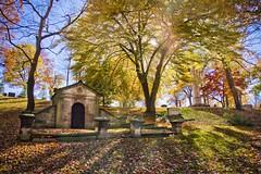 Glendale Cemetery, Akron Ohio (pyathia) Tags: old blue autumn trees sunset shadow ohio red sky orange sun fall cemetery grave yellow set project lens evening glendale antique mausoleum flare akron
