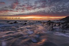 Gunwalloe (Joe Rainbow) Tags: ocean sunset seascape water landscape flow coast cornwall tide incoming coastline gunwalloe visipix