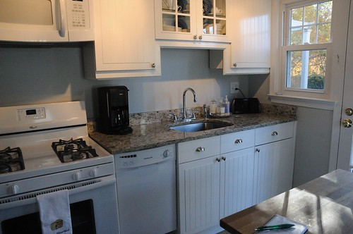 white kitchen cabinets, granite counter