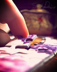 Purple Puzzle Pieces (Sparkey Davis) Tags: camera macro closeup contrast photoshop photography evening arty purple desk finger progress puzzle indoors cardboard processing teapot jigsaw piece curve dim compact ravensburger
