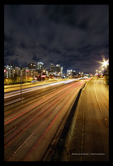 Bellevue DRI (Bryan Koorstad) Tags: road trees light usa cloud art cars skyline night clouds canon buildings dark lens landscape photography lights town photo highway long exposure downtown traffic dynamic angle jonathan wide sigma down bryan photograph freeway wa multiple 1020mm cinematic range dri increase bellevue 2012 2010 exposures dynamicrangeincrease 2011 550d danker nohdr t2i draken413o bryankoorstad koorstad
