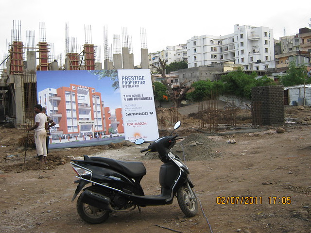 Pate Developers' Kimaya, 2 BHK Flats has 3 Buildings and 4th Building in the plot is Prestige Properties, 20 Units of 2 BHK Flats & 1 Row House for 1.5 Cr. by Pune Agrocon Pvt. Ltd.