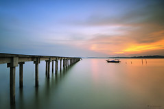 towards the horizon.. (sirman88) Tags: sunset cloud seascape motion water outdoors photography boat interestingness nikon dusk geometry jetty pantai calmness f9 waterscape pasirpanjang revisited nd400 2011 d90 traveldestinations colorimage glorioussunset negerisembilan cokingnd8 tokina1116 blinkagain azmanrahman malaysialongexposure sirman88