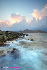 Harsh waves on little rocks . . (Beauty Eye) Tags: longexposure sunset sea seascape black beach clouds canon iso100 waterfall rocks filter f80 grad tamron oman snails muscat 30seconds 1024   blendedexposures 600d  yiti  seawaves yitti f110 f160  yitty