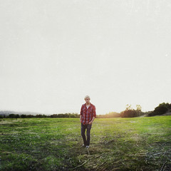 A fall stroll, with no hand to hold. (David Talley) Tags: red orange sun guy green fall field grass vintage walking lens sad horizon jeans lensflare indie flare flannel stroll strolling wwwgewinnspiel3000wordpresscom