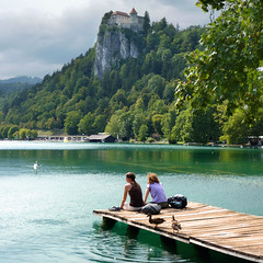 Enjoying the overwhelming beauty of Bled (B℮n) Tags: world travel blue girls summer two mountain lake holiday alps castle feet water beauty swim relax geotagged island swan topf50 women hiking relaxing ducks tourist medieval romance topf300 slovenia alpine bled rowing romantic championships picturesque topf100 idyllic topf200 attraction kasteel slopes barna glacial overwhelming 2011 blejski 100faves 50faves 200faves pletna veldes 300faves geo:lon=14108258 geo:lat=46368543