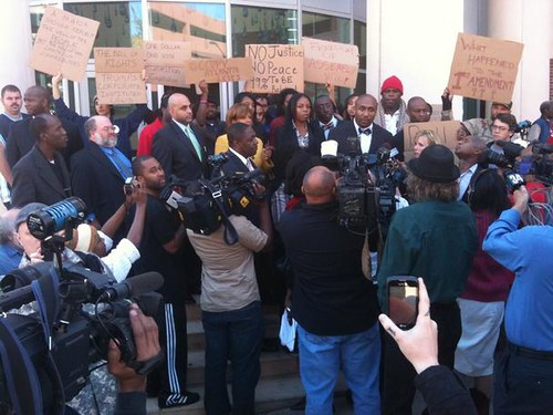 Rally in Atlanta outside police headquarters after people were arrested in the Occupy Atlanta protest movement. Occupy movements have spread throughout the U.S. and the world. by Pan-African News Wire File Photos