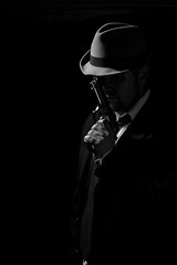 Gangster Daddy - Last Prayer. (CJsarp) Tags: blackandwhite bw hat thirties gangsters gun niceshot flash tie suit pistol canon5d whacking canon50mm18 580exii 430exii