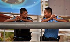 (Bosquet) Tags: poverty street people men smile mexico nikon chat cops faces border poor police nik tijuana persons talking nikond700