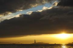 Sunset over Battery Park and Statue of Liberty (Dan Nguyen @ New York City) Tags: nyc sunset sun newyork fall clouds landscape evening manhattan batterypark gothamist statueofliberty