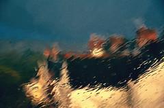 .. (Trees n stuff) Tags: window rain landscape rooftops chimneys