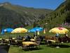 Relaxing in the Austrian Tyrol (saxonfenken) Tags: blue mountains yellow umbrella relax restaurant austria cliffs tyrol chiars gamewinner 8010 challengewinner yourockwinner pregamewinner 8010house