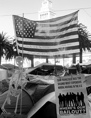 Occupy SF: Various Signs (shaire productions) Tags: sf sanfrancisco street city urban blackandwhite bw streets photo blackwhite democracy image political politics photojournalism documentary photograph metropolis sfbayarea grayscale narrative freespeech imagery occupy occupywallstreet occupysf occupysanfrancisco