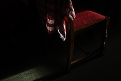 Evening draws in (Skink74) Tags: light shadow red sunlight 20d dark evening chair canoneos20d cloth lowkey chiaroscuro teatowel nikkor35f14 nikkor35mm114ai