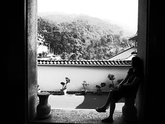 Summer Solitude (Trim Reaper) Tags: travel bw lady contrast temple photography blackwhite high alone sitting buddha candid buddhist si malaysia penang ricoh kek lok sooc grd3 grdiii